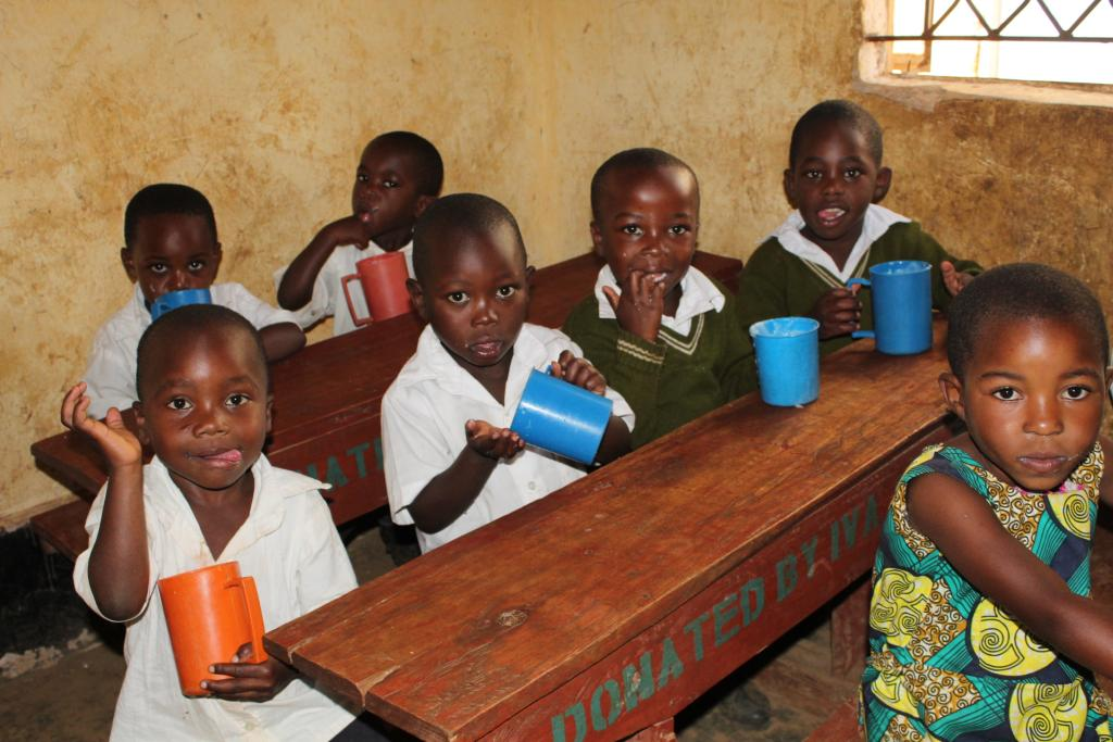 Children enjoying a mid-morning glass of milk in their classroom